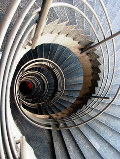 "Vortex of the spiral staircases in the ""Universidad Distrital"" building ""Sabio Caldas"" seen from the 7th floor"