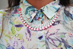 Necklace on floral shirt