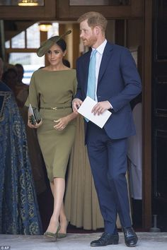 The Duchess of Sussex, 36, teamed the belted dress by Ralph Lauren with a co-ordinating hat by Stephen Jones