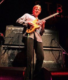 Allan Holdsworth, master (or should that be meister?) guitar player and Hughes & Kettner player! This is a great live shot of him in front of some of our stacks ;)
