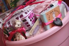 Baby shower gift of useful stuff....I'd agree on the general idea here, but my tub would hold a few different brands/things.  Those arm n hammer diaper bags being one of them....