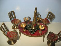 Vintage Brass Doll s House Furniture. Table, four chairs and a tea set.