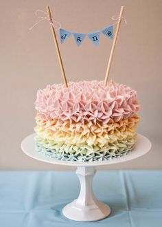 Rainbow frosted cake, smash cake, natural food coloring.  The Wolfepack Chronicles: Janes Rainbow First Birthday Party
