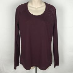 """♣️ The North Face base layer vapor wick l/s shirt This is a North Face base layer. A gorgeous burgundy with flower print. Size large. Made of 100% polyester. Bust 38"""" length 24"""". Mint condition. 👗👖 All items are from a clean, smoke free home 🌟 We ❤️ offers but will only be considered by using the """"OFFER"""" option 🚫 Trades 🚫 Modeling North Face Tops Tees - Long Sleeve"""