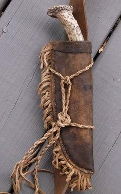 Heres a very special mountain man possibles bag with a knife and matching sheath attached to the strap. Keep in mind that the price is for a knife and sheath and bag. This bag is made of deer tanned cowhide to endure the elements and lots of use. Many layers of stains and waxes were added to