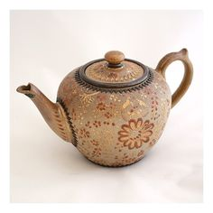 Intricate early 19th Century English earthenware teapot.