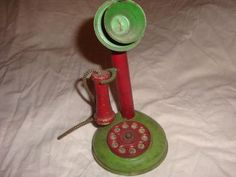 antique toy candle stick phone. cool colors!