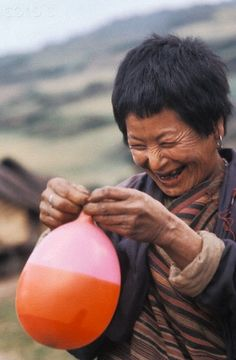 Laughing woman with balloon, Bhutan www.smartmat.com  is a portable Yoga Mat which helps to track, improve & perfect yoga practice  #yoga