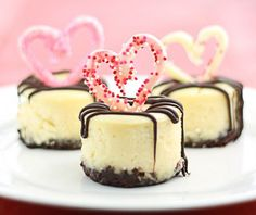 Mini Cheesecakes with a Nutella crust, topped with chocolate hearts & a chocolate-stuffed raspberry center. They really are the Best Mini Cheesecakes Ever (and they're EASY)!