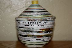 Lidded Recycled Poster Bowl  Recycled posters and magazines have never looked so beautiful.  These products are made from multiple layers of rolled, coiled, and lacquered reclaimed paper.  They come in a kaleidoscope of colors.