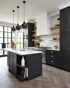 Design inspo: Beautiful black kitchens - STYLE CURATOR Designing a new kitchen and thinking of using black cabinets? We love the impact of black, it can suit a range of styles. Here are the best black kitchens Black Kitchen Cabinets, Kitchen Cabinet Remodel, Black Kitchens, Cool Kitchens, Kitchen Black, Green Cabinets, White Cabinets, Kitchens With Dark Cabinets, Kitchen Cabinetry