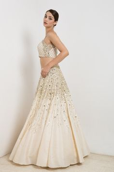 Off white lehenga in raw silk with embroidery