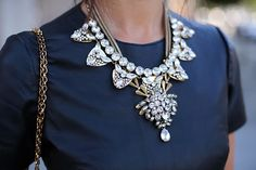 Simple silk top and and intricate jeweled bib necklace for a fashion statement.