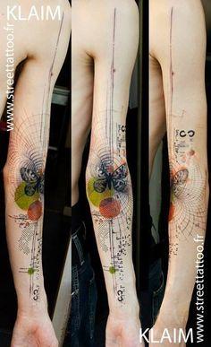 Geometric butterfly tattoo.