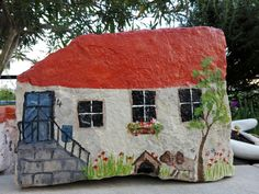 painted fairy rock house acrylic craft paint sealer painted rock fairy house red roof and dog Garden Painting, Pebble Painting, Pebble Art, Stone Painting, Stone Crafts, Rock Crafts, Casa Do Rock, Paint Sealers, Art Pierre