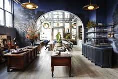 The husband/wife design team Roman & Williams recently opened Guild, a concept restaurant/cafe/flower shop and bookstore bringing a new dose of glamour to SoHo, New York. Located at 53 Howard St. on a 7000 square-foot two-story of a former luxury department store called Arnold (Constable & Company). The restaurant is the French café La Mercerie, …