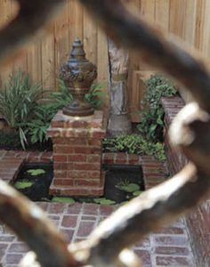 Paxton transformed a diminutive backyard into a chic brick courtyard.