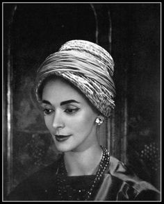 Kouka Denis in turban hat of silk printed with roses and pink chiffon band wrapped around, by Gilbert Orcel, photo by Georges Saad, 1957