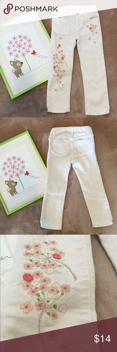 Baby Gap jeans sz 3 years White/Ivory colored jeans with pink embroidered flower details in size 3 years. Has adjustable waist straps, straight leg style, 67% cotton, 32% polyester, 1% spandex. In excellent condition, no known holes, stains or defects. Shows normal wear & wash. Comes from let & smoke free home. GAP Bottoms Jeans