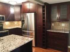 """Design Firm: Make It Home 3"""" Shaker doors with Cappuccino stain Expression Collection Brushed Oil Rubbed Bronze handle Dovetail soft close drawer boxes #Cabinet #Countertops"""
