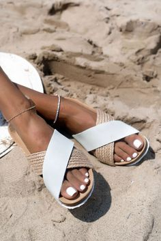 Premium slip on sandals with leather and jute criss-cross straps that compliment any ensemble.