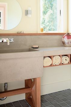 Concrete / Redwood Vanity//I love the rolled towel cubbies and the sink...