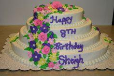 4 Tier Oval birthday cake with fondant flowers.