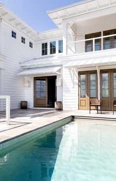 Probably our number 1 exterior look. Good add detail under sofet of existing house to unite the two. Pretty coastal, like the wood doors. weekend wishes – Greige Design Home Upgrades, Style At Home, Outdoor Spaces, Outdoor Living, Deco Design, Design Design, Glass Design, Coastal Homes, Exterior Design