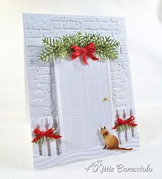 Kitty at the Christmas Door