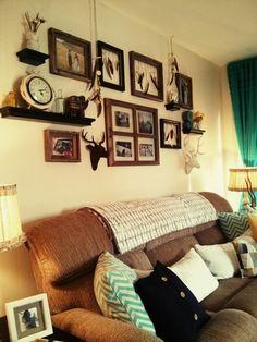 Rustic living room - tan white aqua decor - feather decor - deer head - floating shelves