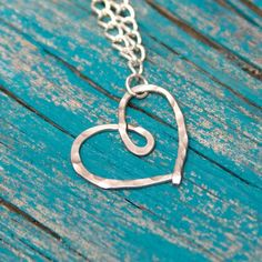 Learn how to make hammered jewelry, starting with this Hammered Heart Necklace DIY by Happy Go Lucky.