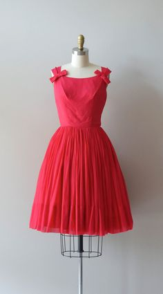Vintage 1950s ruby red silk chiffon dress with bows at each shoulder strap, nipped waist and full layered silk chiffon skirt. Metal back zipper and