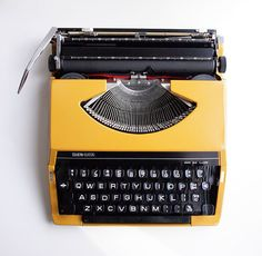 Vintage typewriter  Mustard Yellow  1970s by thelovefleas on Etsy, £95.00    I learned to type on one similar, that takes me back.