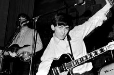 One of very few photos I've run across, with George cutting it up ... for the most part, it seems that was Paul's mission in life.