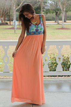 """Oh my gosh, we can't wait to snatch this maxi up for our closet! The material and embroidered details of the bodice are absolutely to die for, and we love the contrast of the peach skirt, sheer with a full lining. Just add wedges and some bangles for fabulous look!   Fits true to size. Miranda is wearing a small.   From the shoulder to the hem:  Small-59""""  Medium-59.5""""  Large-60"""""""