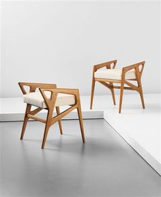 GIO PONTI Pair of stools, 1950s Walnut, fabric. 54 x 45 x 46.5 cm (21 1/4 x 17 3/4 x 18 1/4 in)