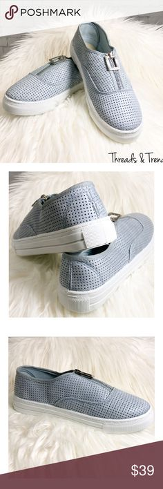 Azure Blue Slip On Sneakers Super cute perforated azure blue slip on sneakers. Featuring a functioning silver zipper. Thick rubber upper sole. The trend of the season. Threads & Trends Shoes Athletic Shoes