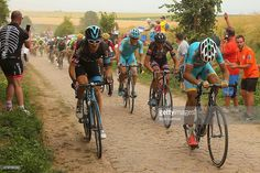 Geraint Thomas (l) of Great Britain and Team SKY rides alongside Vincenzo Nibali of Italy and the Astana Pro Team on stage four of the 2015 Tour de France, a 223km stage between Seraing and Cambrai, on July 7, 2015 in Cambrai, France. #TDF2015 #rm_112