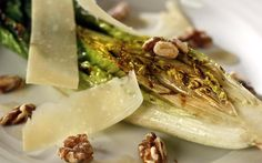 Fix a simple weekday dinner outdoors tonight with this grilled romaine recipe from former Food columnist Russ Parsons. Crunchy romaine lettuce hearts are brushed with a quick Caesar-likedressing combining anchovies with garlic, lemon juice and olive oil, then charred over a hotgrill for a couple of minutes. Top the lettuce with shaved Parmesan and toasted walnuts and you've got dinner.