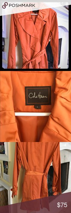 Cole Haan Ruffle Trench Coat L New never worn!  Color is a gorgeous rich burnt orange.  Would be perfect for spring or fall.  Large ruffle down he front that fades into the collar.  Sleeves have adorable bows and the hem has a skirted ruffle along the edge.  Perfect classy and elegant look. Cole Haan Jackets & Coats Trench Coats