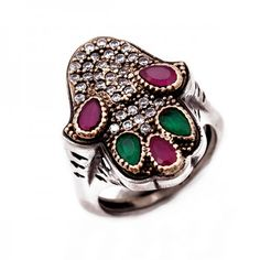 Vintage Hamsa Hand or Hand of Fatima Evil Eye Ring. Unique design - 925 Silver with Ruby Emerald and Clear CZ Stones. The Hamsa amulet was seen as the symbol of holiness, healing and miracles, which would pull the forces of good to the bearer and protect them from unseen dangers, disease, and neutralize the negative energies of envy and the forces of evil.