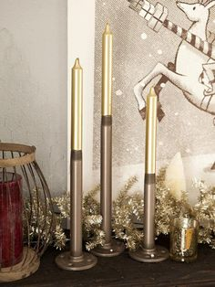 Add steampunk style to your Christmas decor with chic, DIY metallic taper candles. Get more steampunk-inspired Christmas decorating ideas here  >> http://www.diynetwork.com/how-to/make-and-decorate/entertaining/steampunk-christmas-decorating-ideas-pictures?soc=pinterest