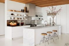 "A little too ""clinical"" but I like the white-alu-wood combo. Architectural Digest"