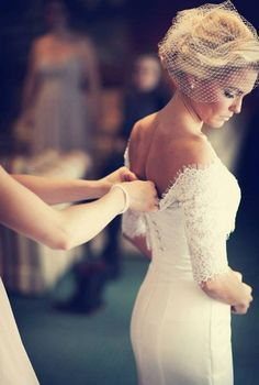 Love the sleeves on this lace wedding dress, so chic and elegant