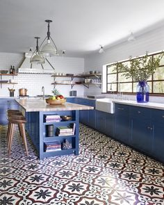 """15.2k Likes, 98 Comments - ELLE DECOR (@elledecor) on Instagram: """"Feeling the blues today 💙 Tap the link in bio to peek inside this lovely 1920s Spanish-style home.…""""  DON'T LIKE THE TILE BUT LIKE THE CABINETS & WINDOWS & SINK COLOR: Farrow & ball hague blue"""