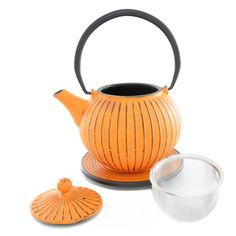 Ja Orange Cast Iron Teapot: Orange cast iron teapot, holds approximately 0.8l, and has a stainless steel removable leaf trap. It comes complete with a matching cast iron trivet.