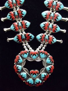 Silver, turquoise, coral and jet squash blossom necklace