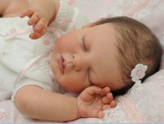 Can you believe this isn't a real baby? It's a reborn baby girl doll.