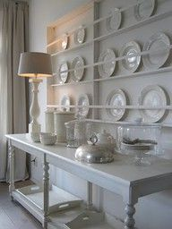 Simple wall rack for plates.