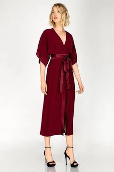 Woven maxi kimono dress with wrap around waist ties, contrast satin ties and panels, pleated bodice, partial lining and open back.  Back neck hook & eye closure with center back invisible zipper. Color: Dark Red